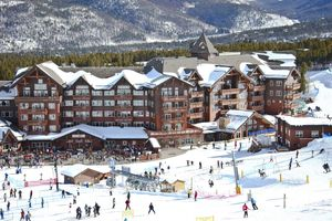 One Ski Hill Place Hotel at Peak8 in Vail with skiers