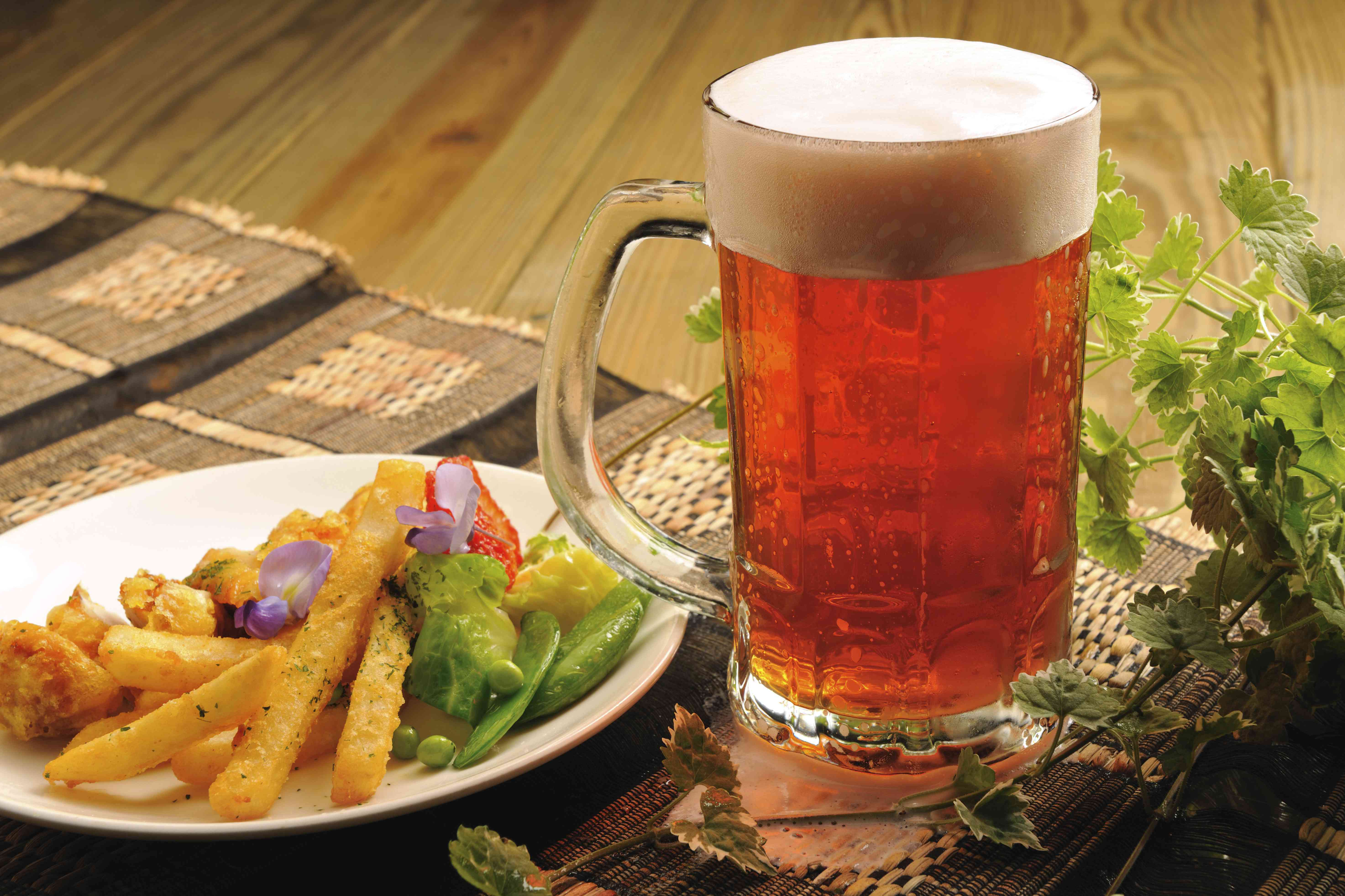 Food portrait of strawberry beer and a plate of French fries