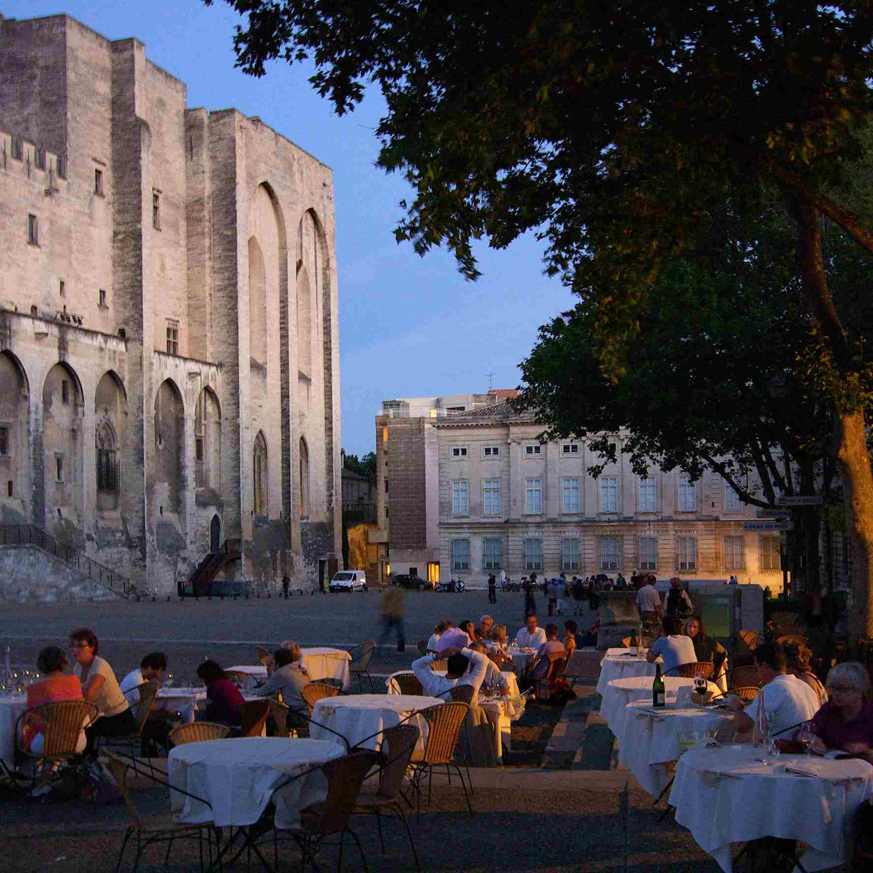 Visitors enjoy evening refreshments at the Place Palais in Avignon