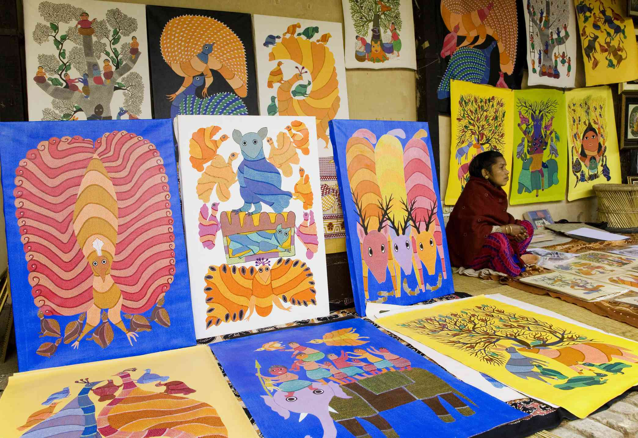 Woman selling paintings at Crafts Museum, Delhi.