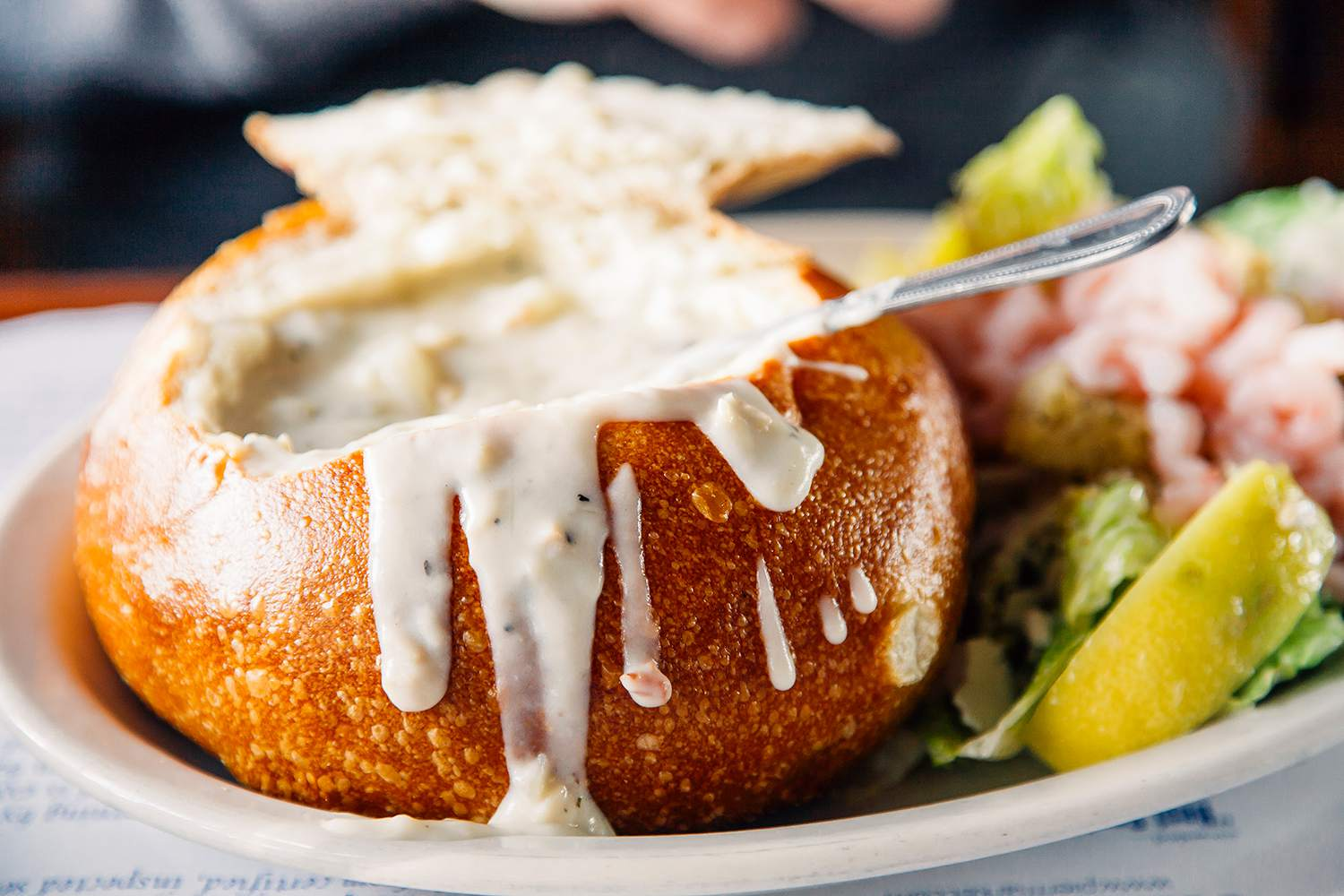 Clam chowder served in a bread bowl