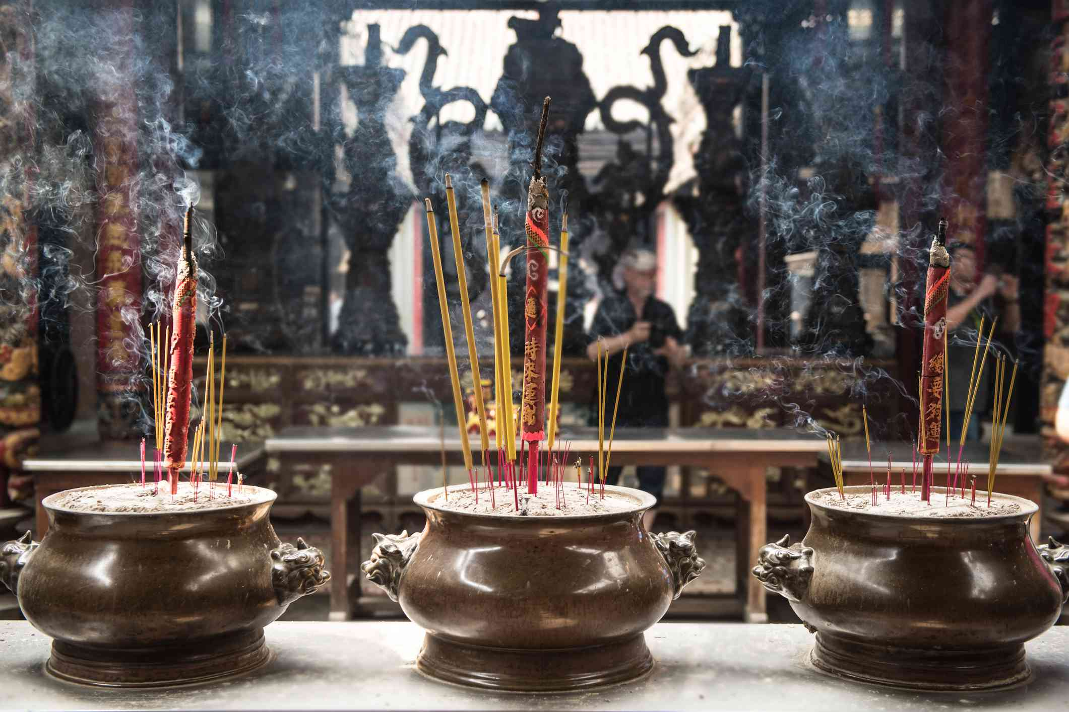 Smoking prayer sticks in copper urns. Thien Hau Pagoda, Ho Chi Minh, Vietnam.