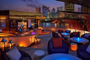 Empty outdoor seating area at Nobu in Doha at night