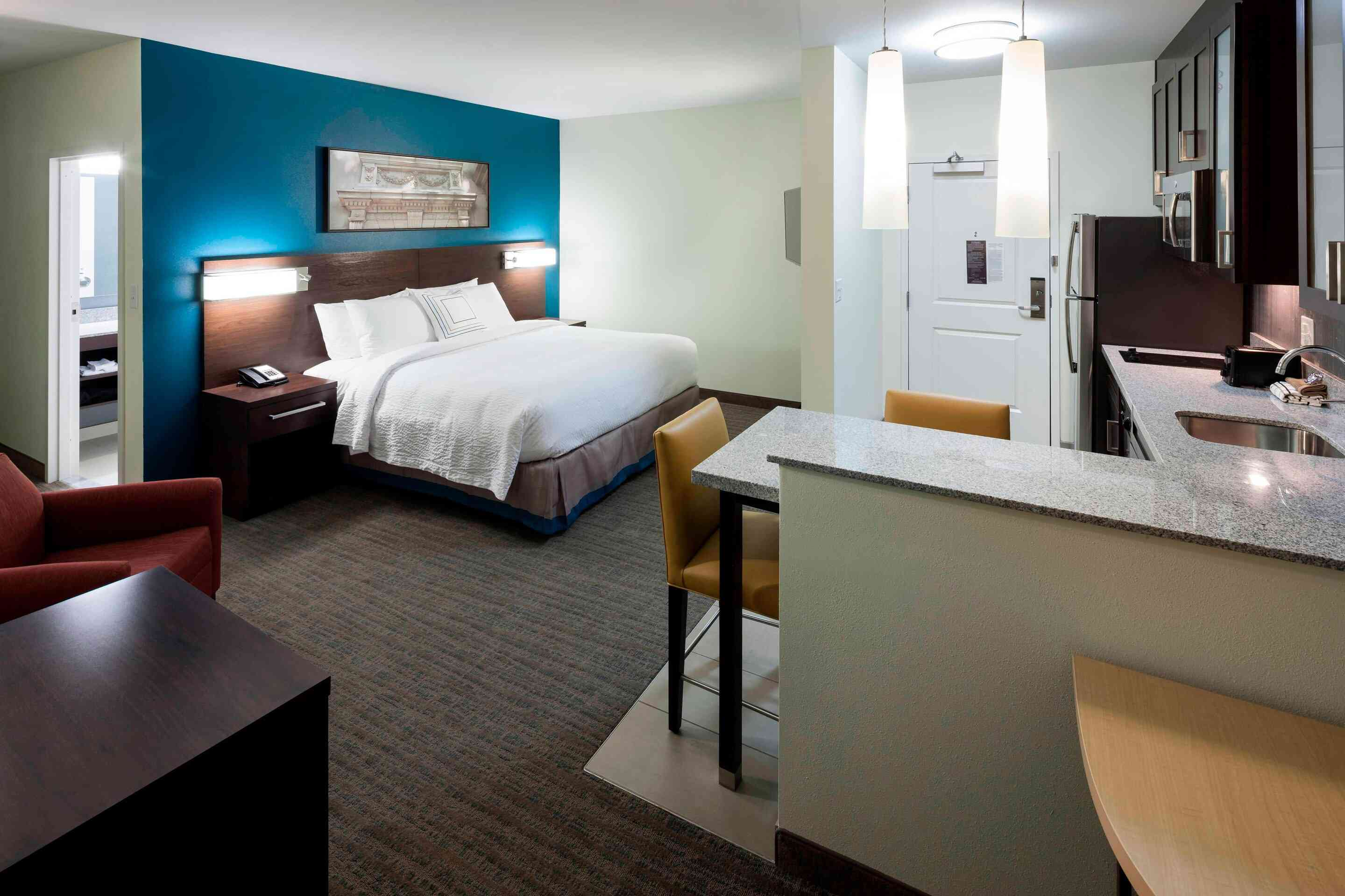 Studio-style hotel room with a kitchenette
