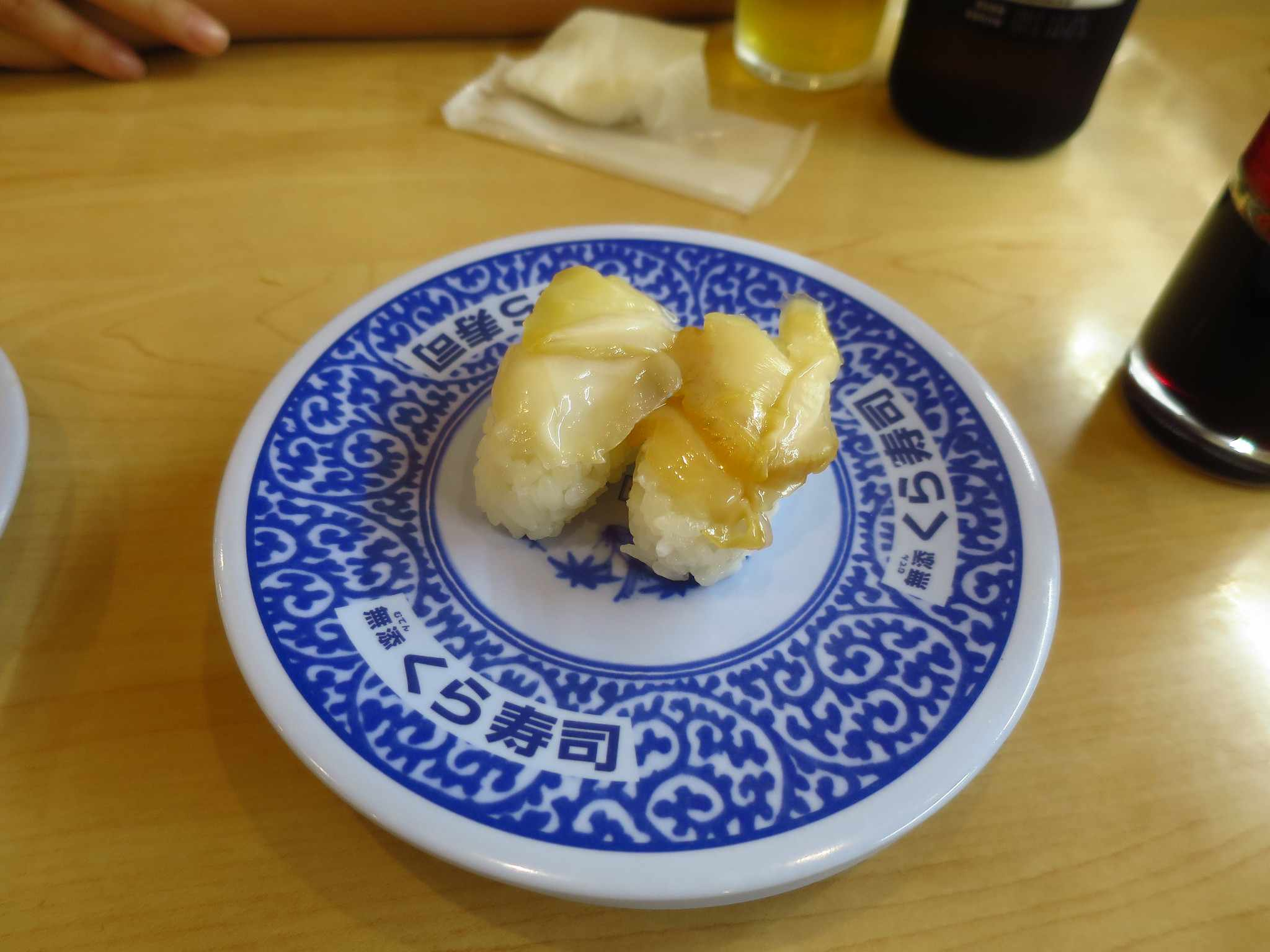 Two nigiri on a blue and white porcelain plate