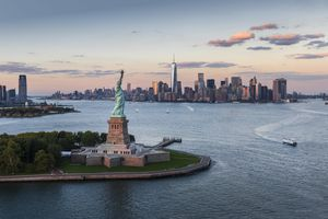 Aerial view of Manhattan with Statue of Liberty at sunset