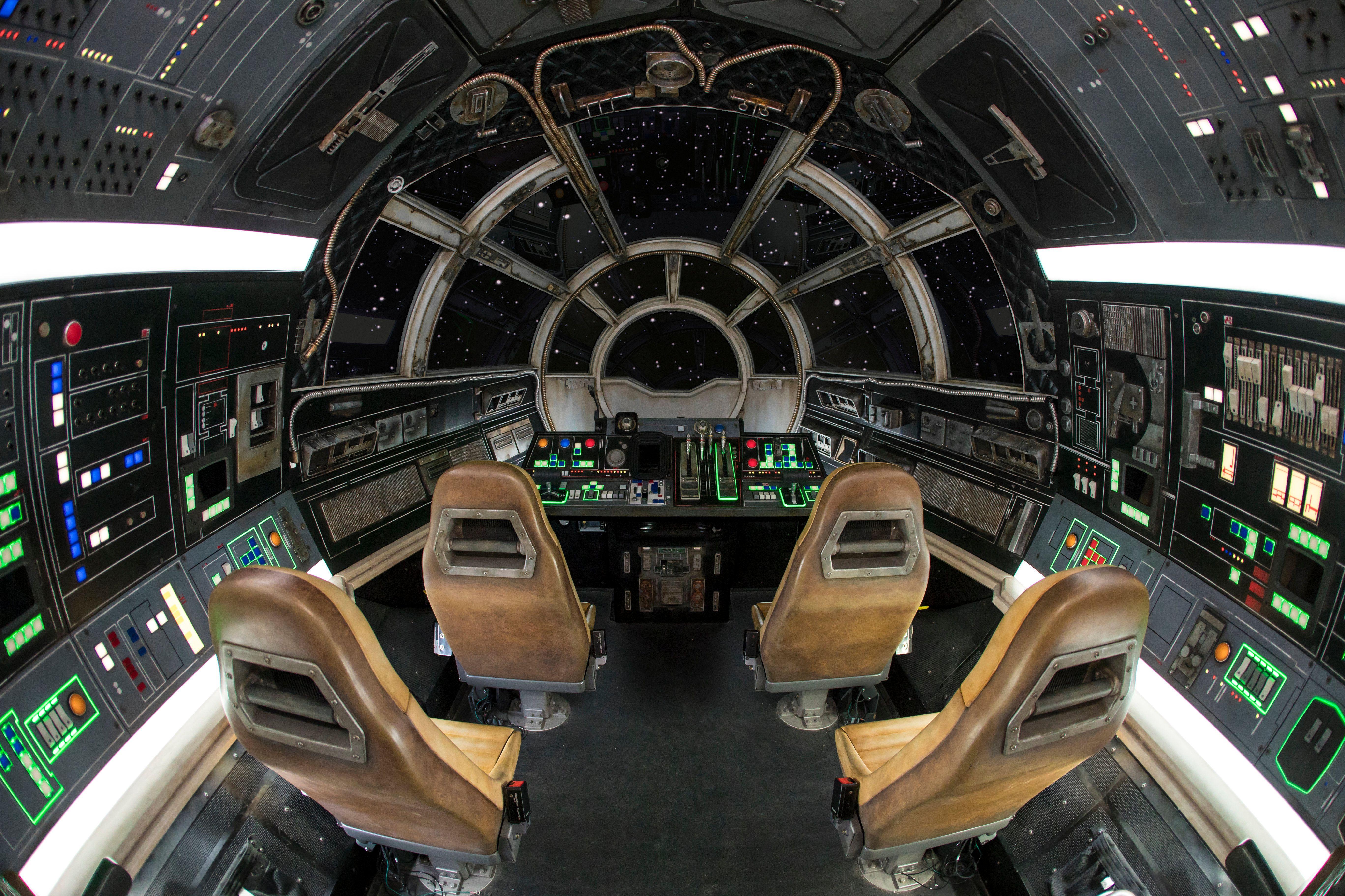 Interior view of Milllennium Falcon: Smuggler's Run at Disneyland showing seating and controls