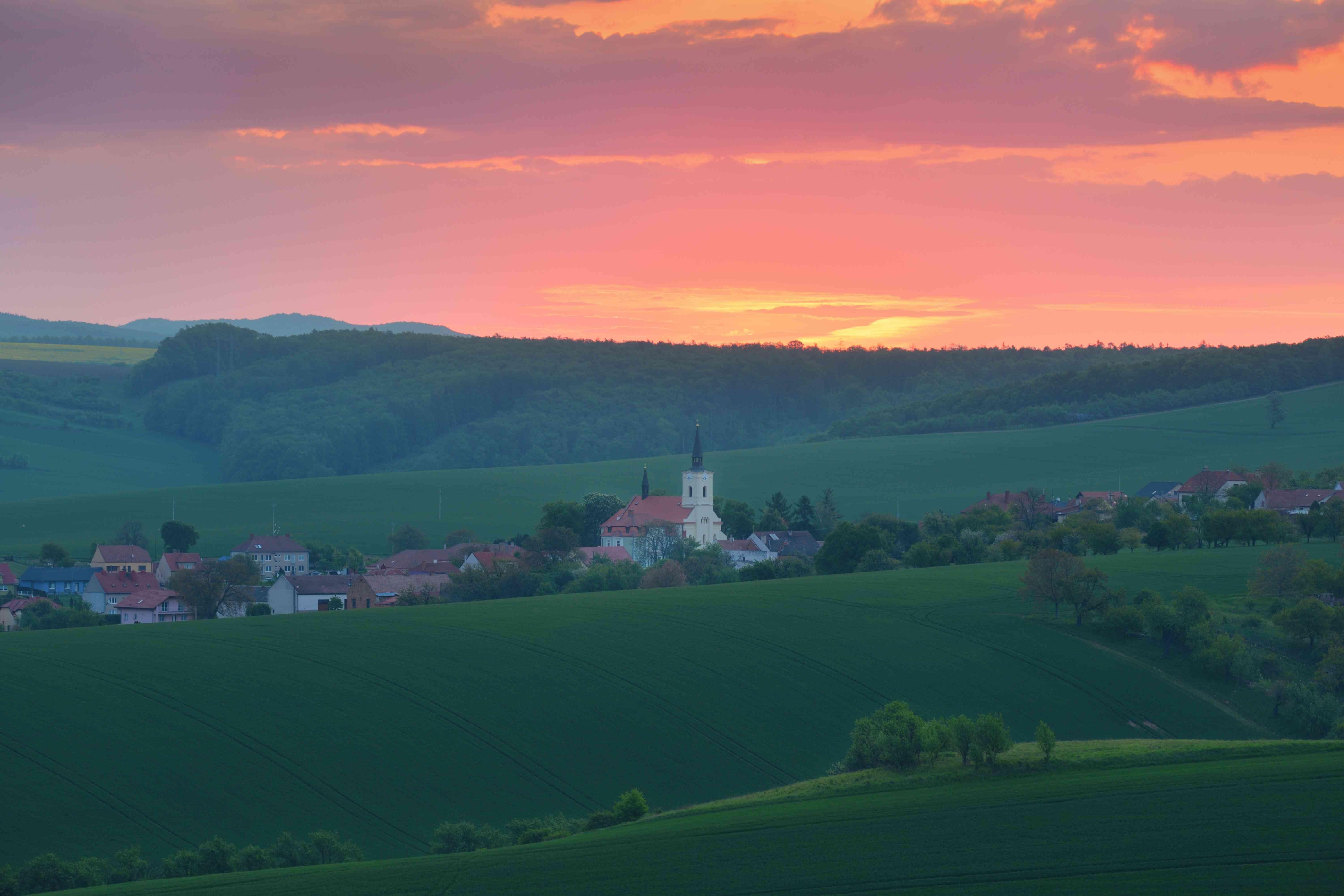 Rural landscape with a church at sunrise South Moravia, Czech Republic