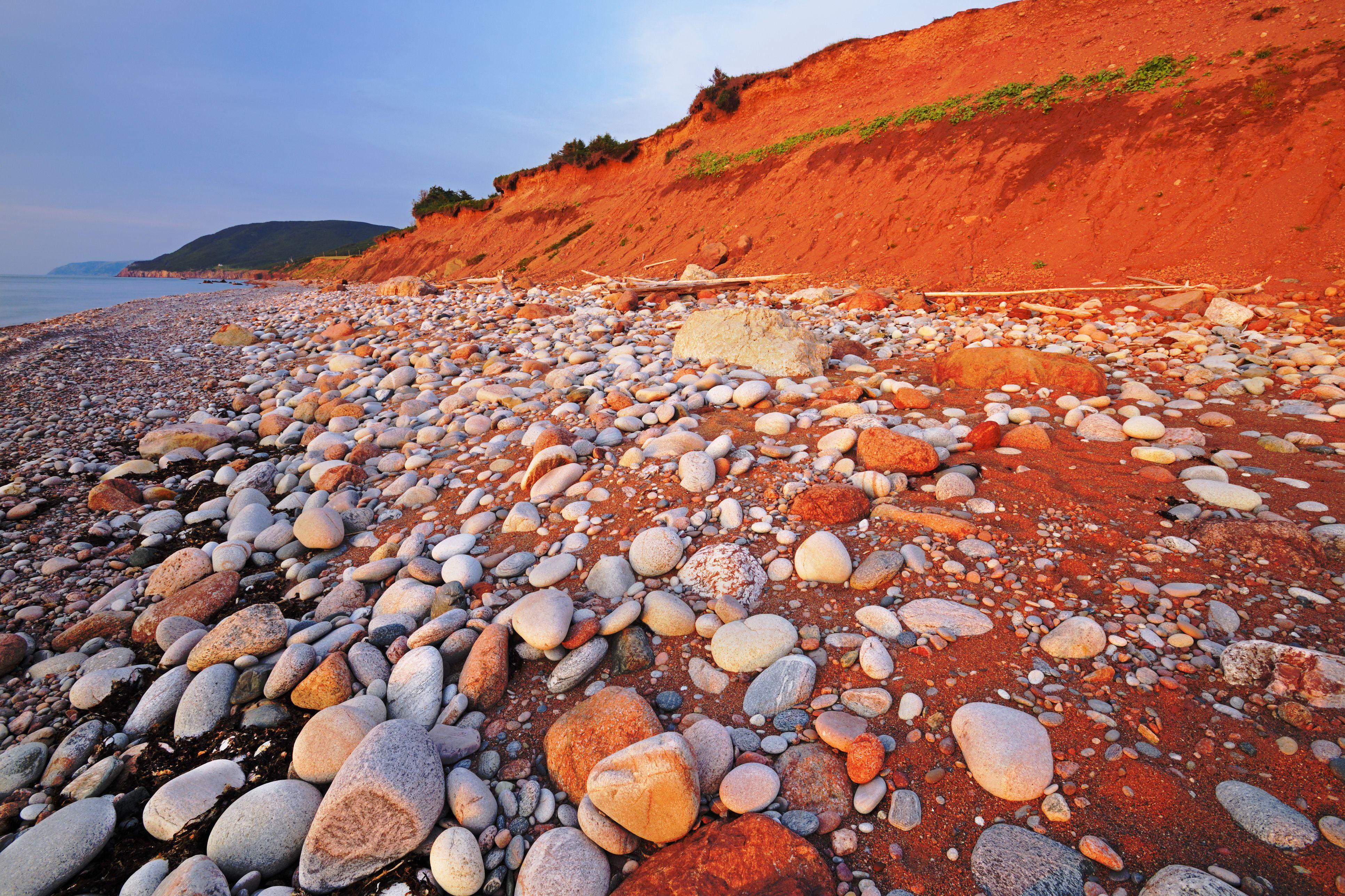 Rocky shoreline at sunset, Pleasant Bay, Cape Breton Island, Nova Scotia, Canada