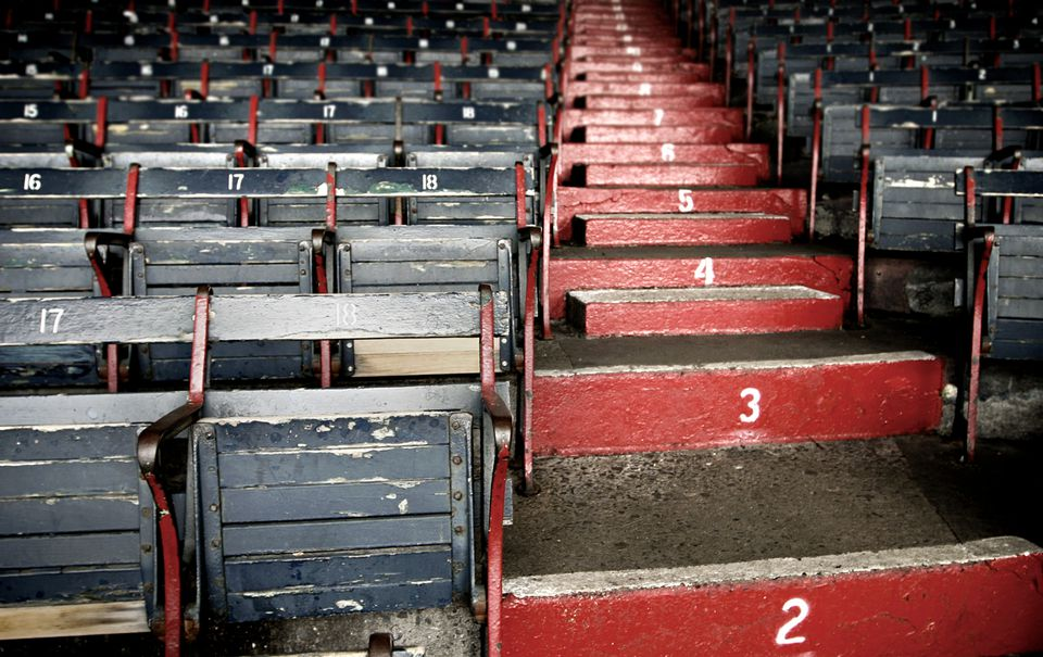 Red painted steps rising between grey stadium seats