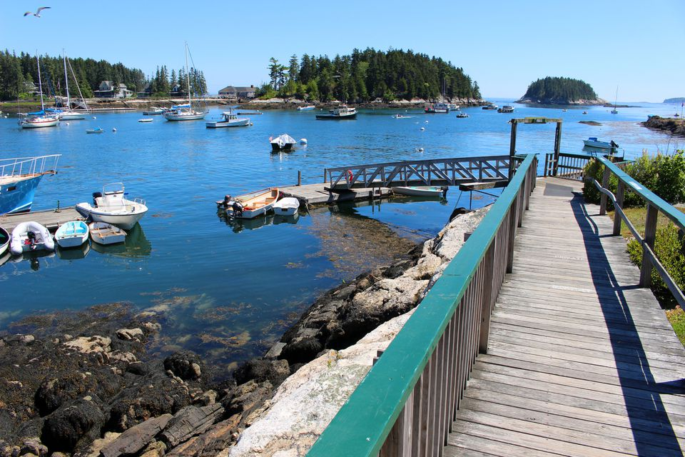 View of the lobstering harbor, boats and islands of the village of Five Islands in Georgetown, Maine, USA.