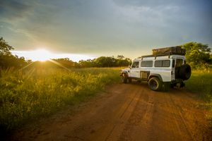 A safari jeep in the African countryside.