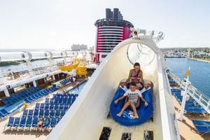 Two children on the AquaDuck water coaster aboard the Disney Dream in Nassau, Bahamas.