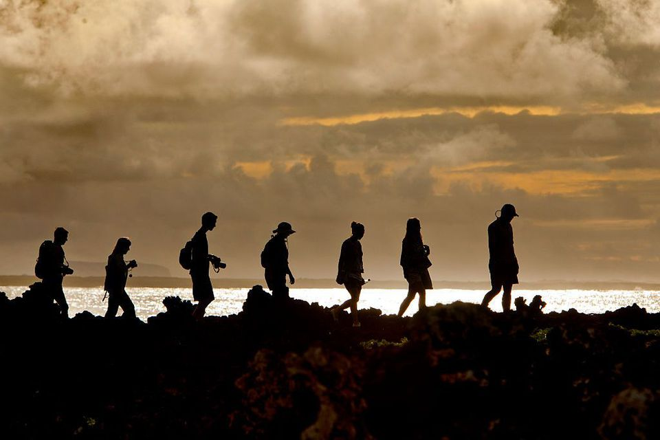 Hikers take a stroll on the Galapagos Islands.
