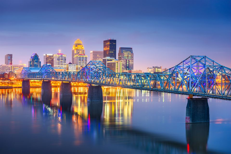 Bridge crossing Ohio River with Louisville skyline