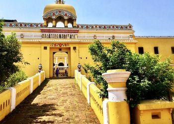 walkway into a yellow palace in Odisha.
