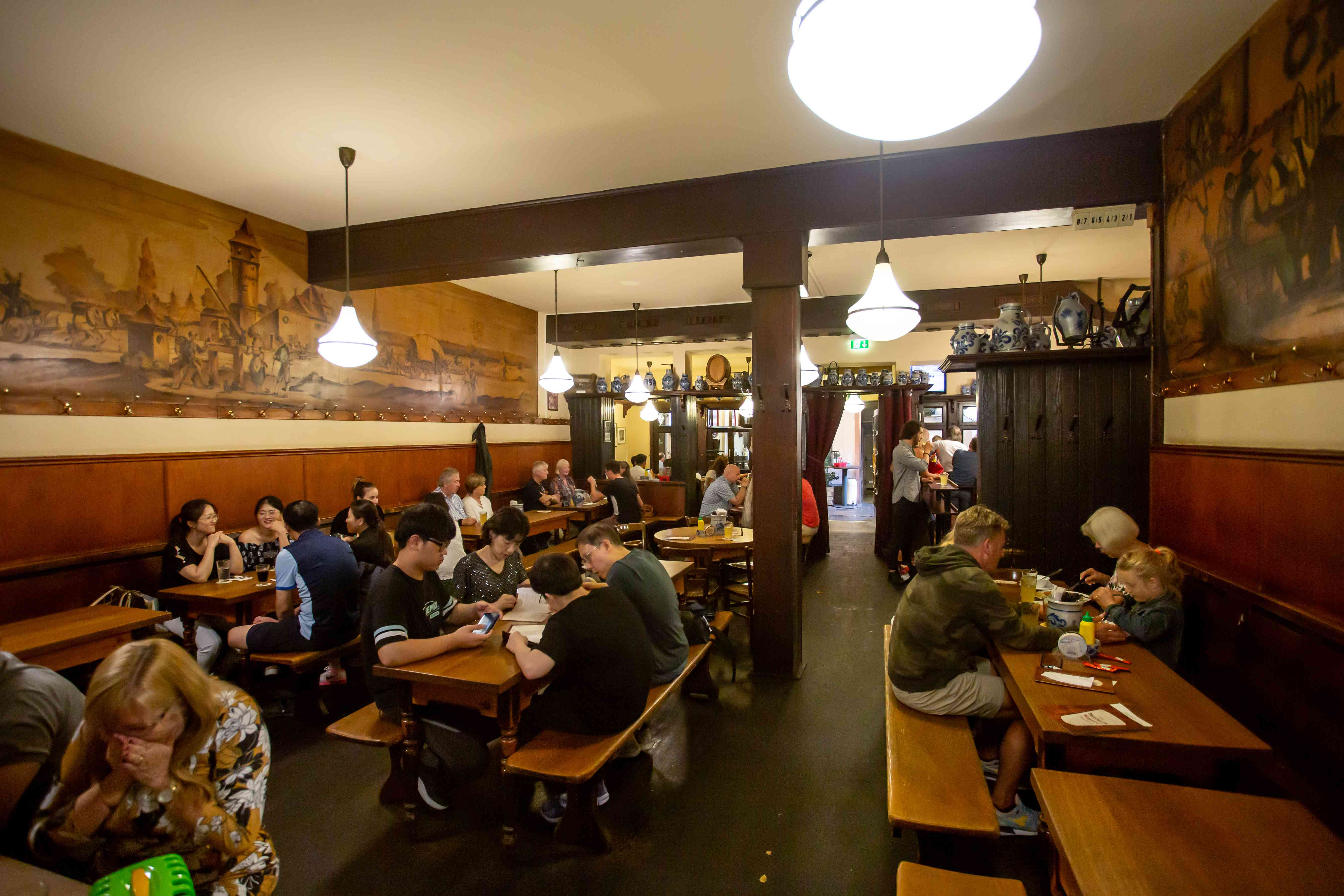 People drinking inside a Cider Tavern