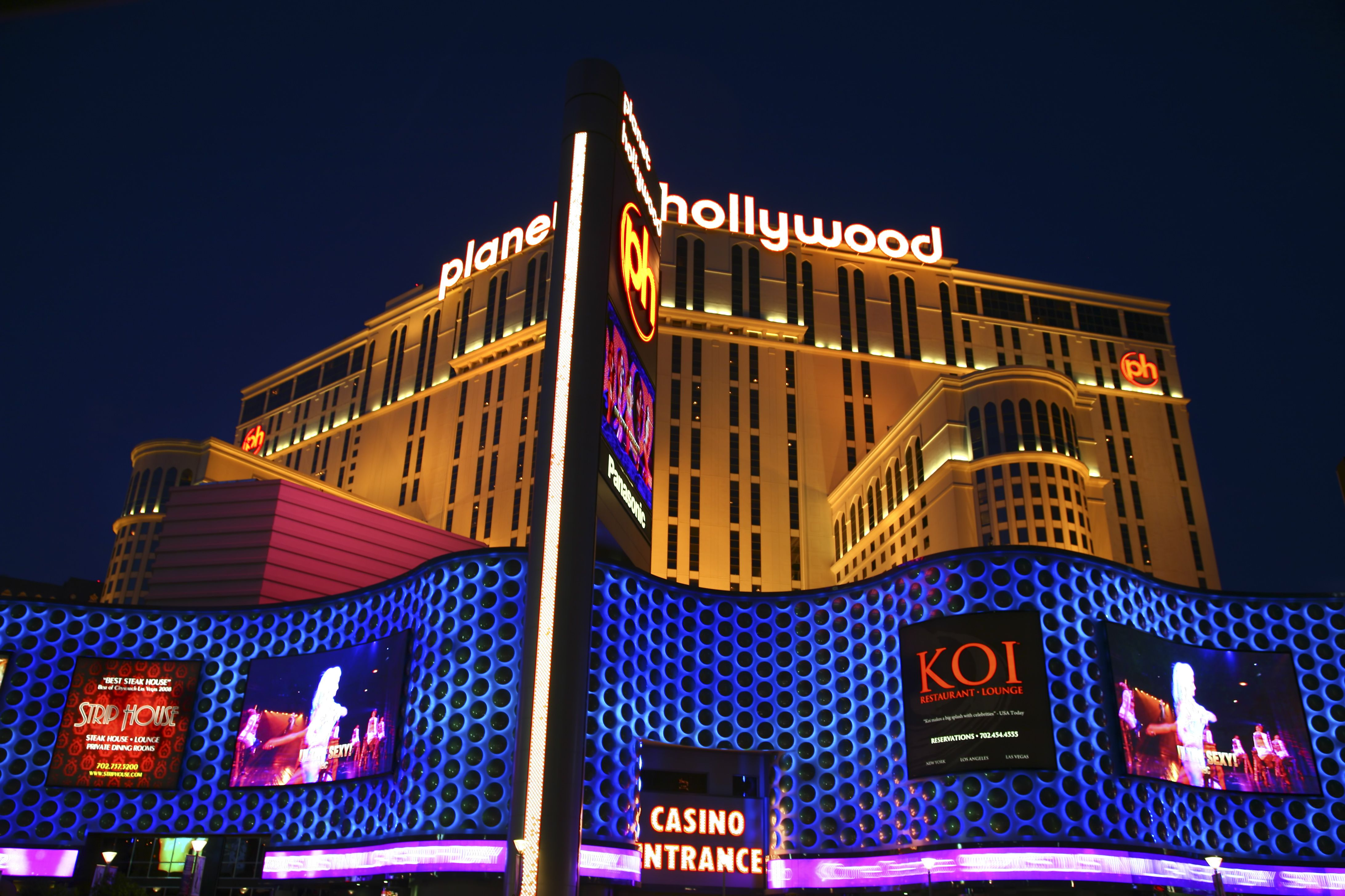 Luminous signs and Planet Hollywood casino and hotel.