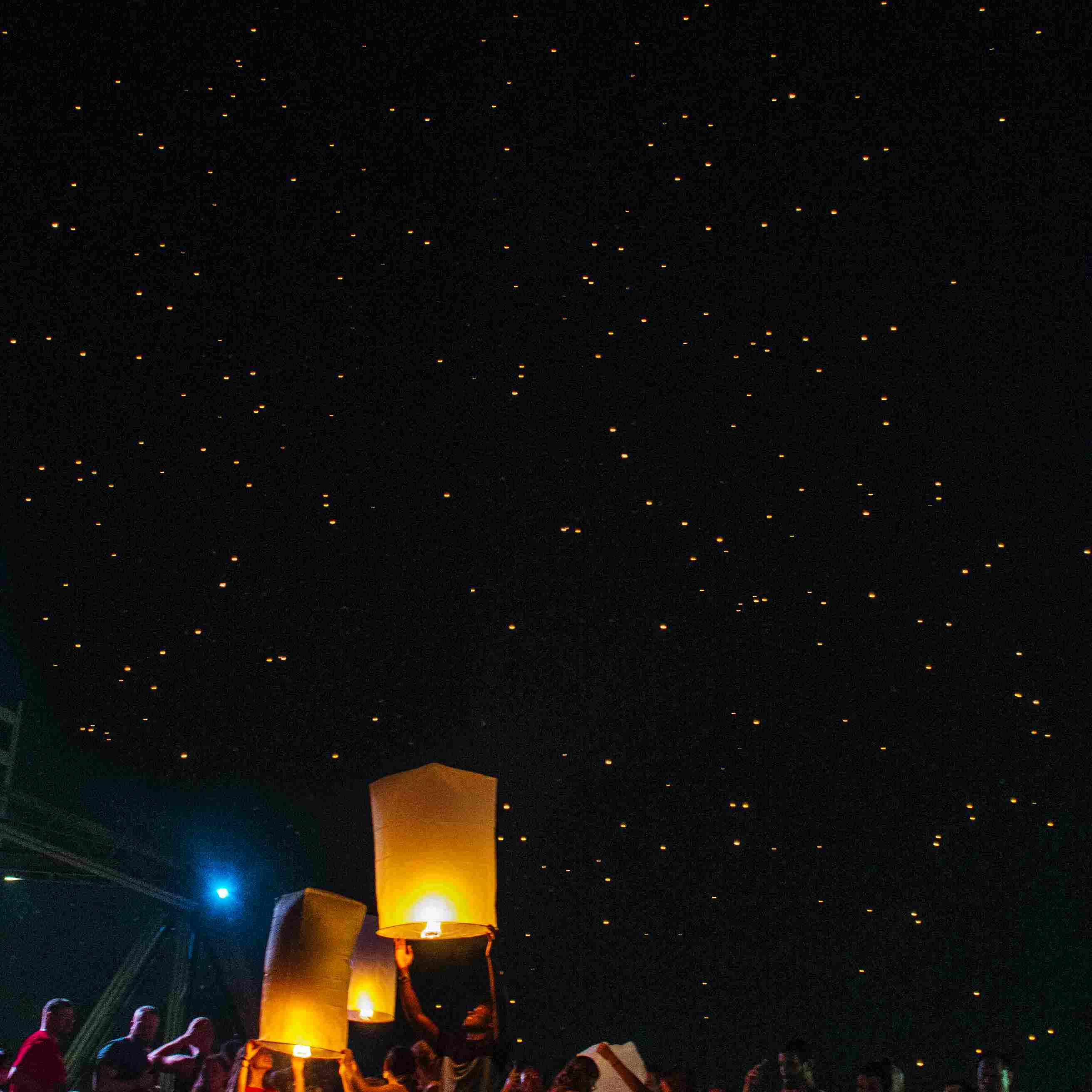 Releasing lanterns at Loy Krathong