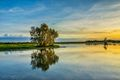 Blue and golden sky reflected in the lake at Kakadu National Park