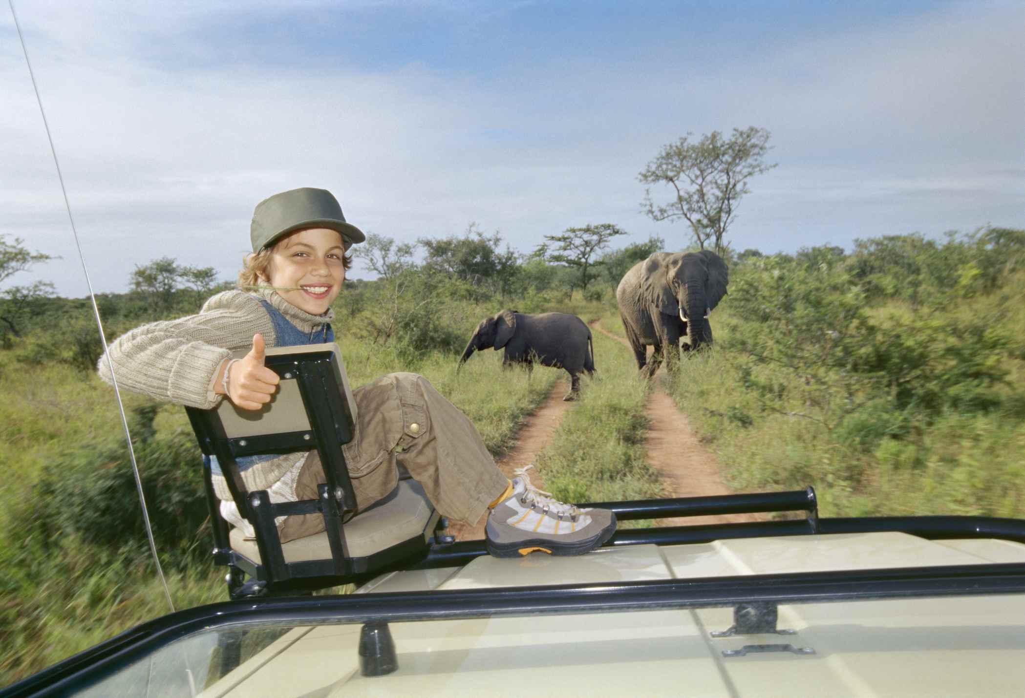 Young Boy with elephants on safari