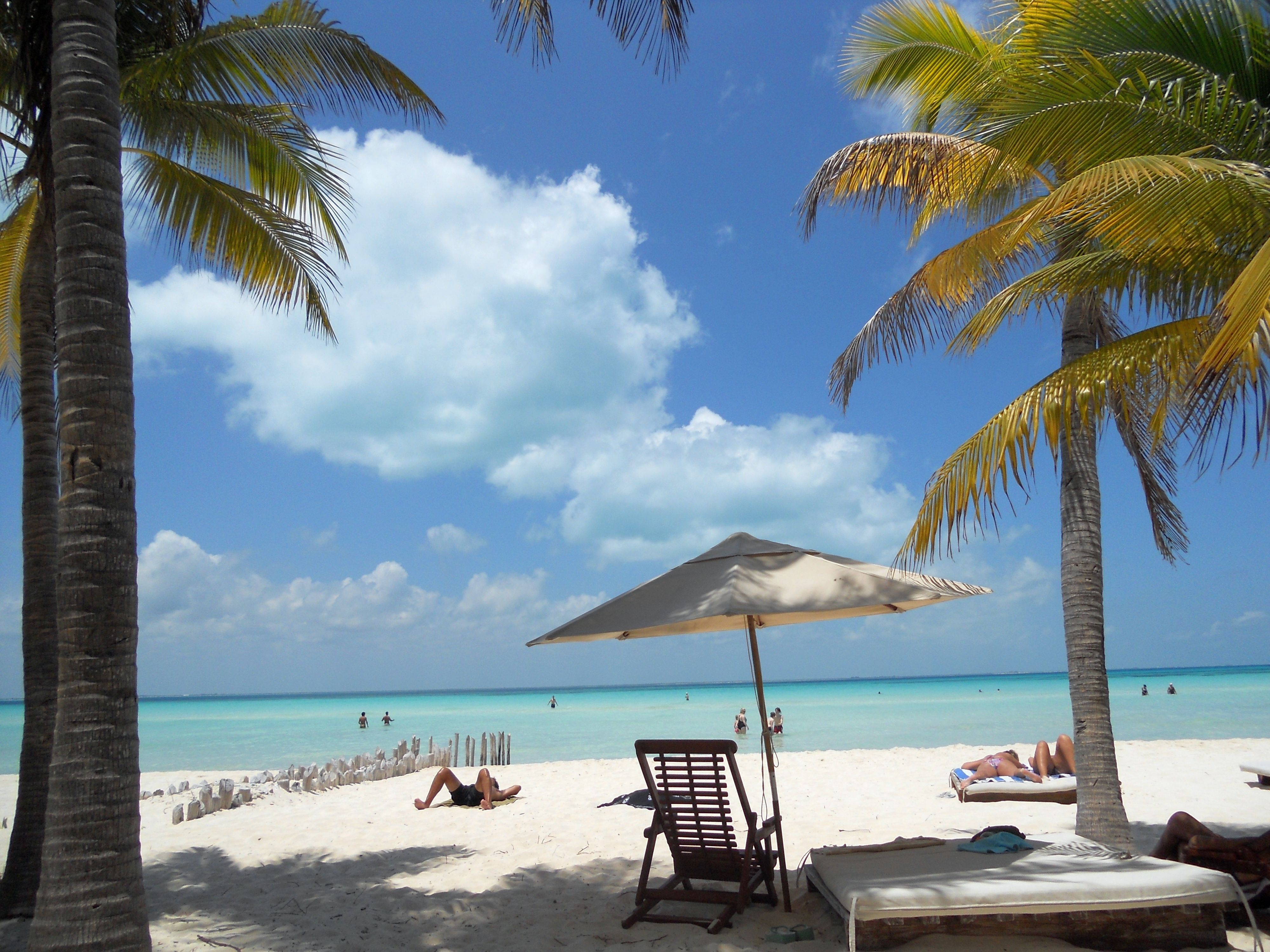 Parasol at the sea shore in Isla Mujeres with its white sand beach