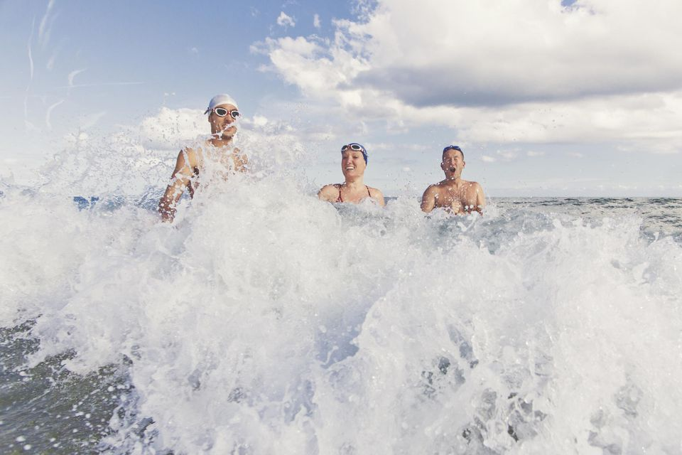 Swimmers in the Mediterranean sea in autumn, Barcelona, Spain