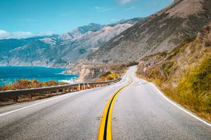 cenic view of world famous Highway 1 with the rugged coastline of Big Sur in beautiful golden evening light at sunset in summer, California Central Coast, USA