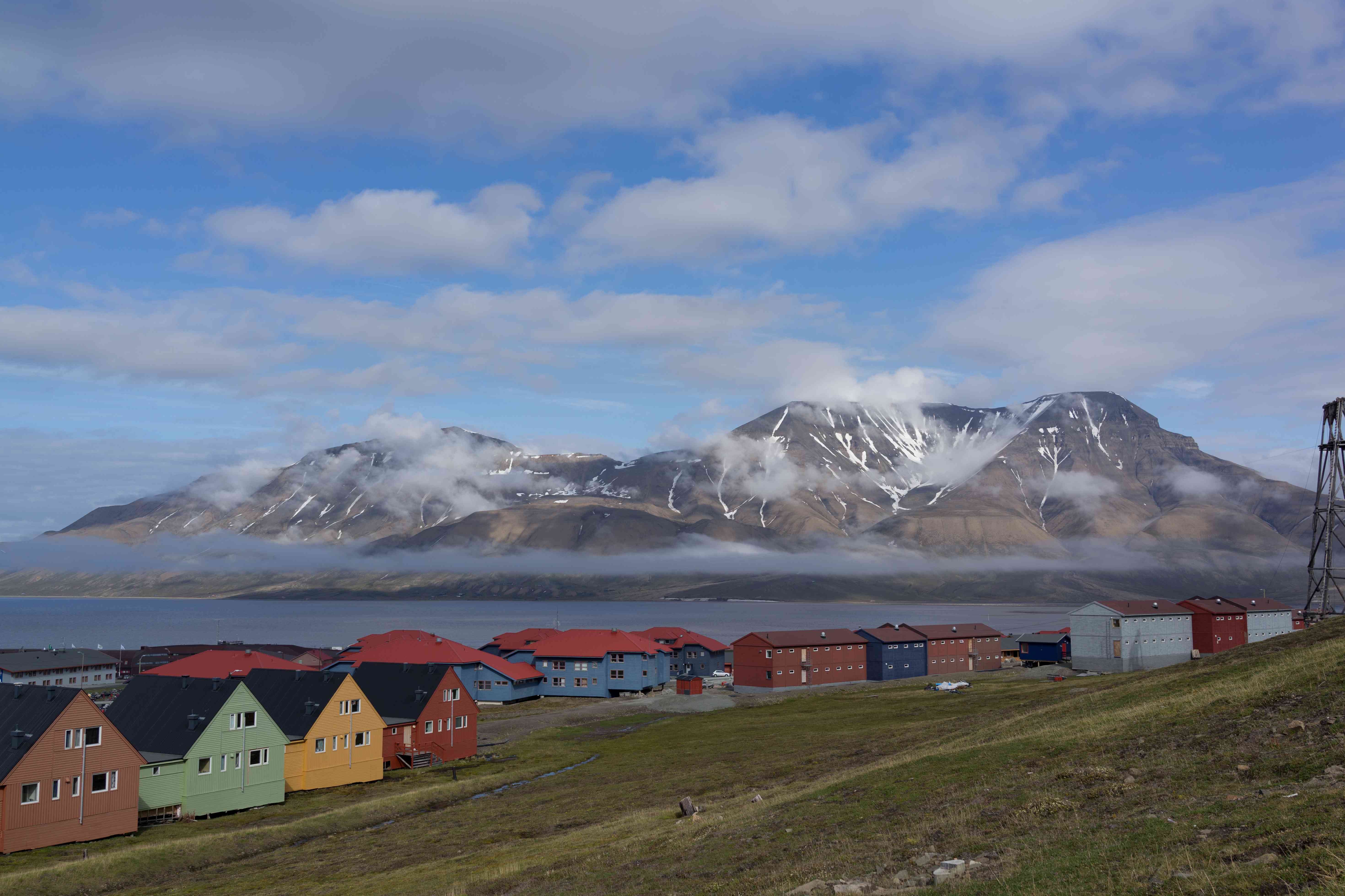 Detached houses with mountains in background, Longyearbyen, Svalbard, Norway