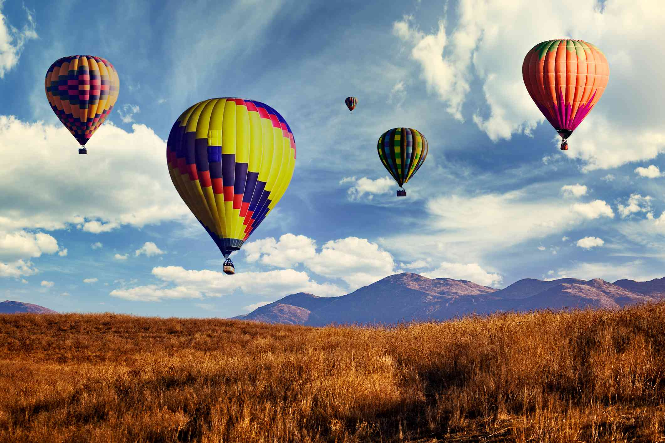 Hot air Balloons Flying over a brown field in Temecula California