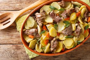 Alsace Baeckeoffe Casserole with meat, potatoes and vegetables, marinated with white wine close-up in a pot. Horizontal top view