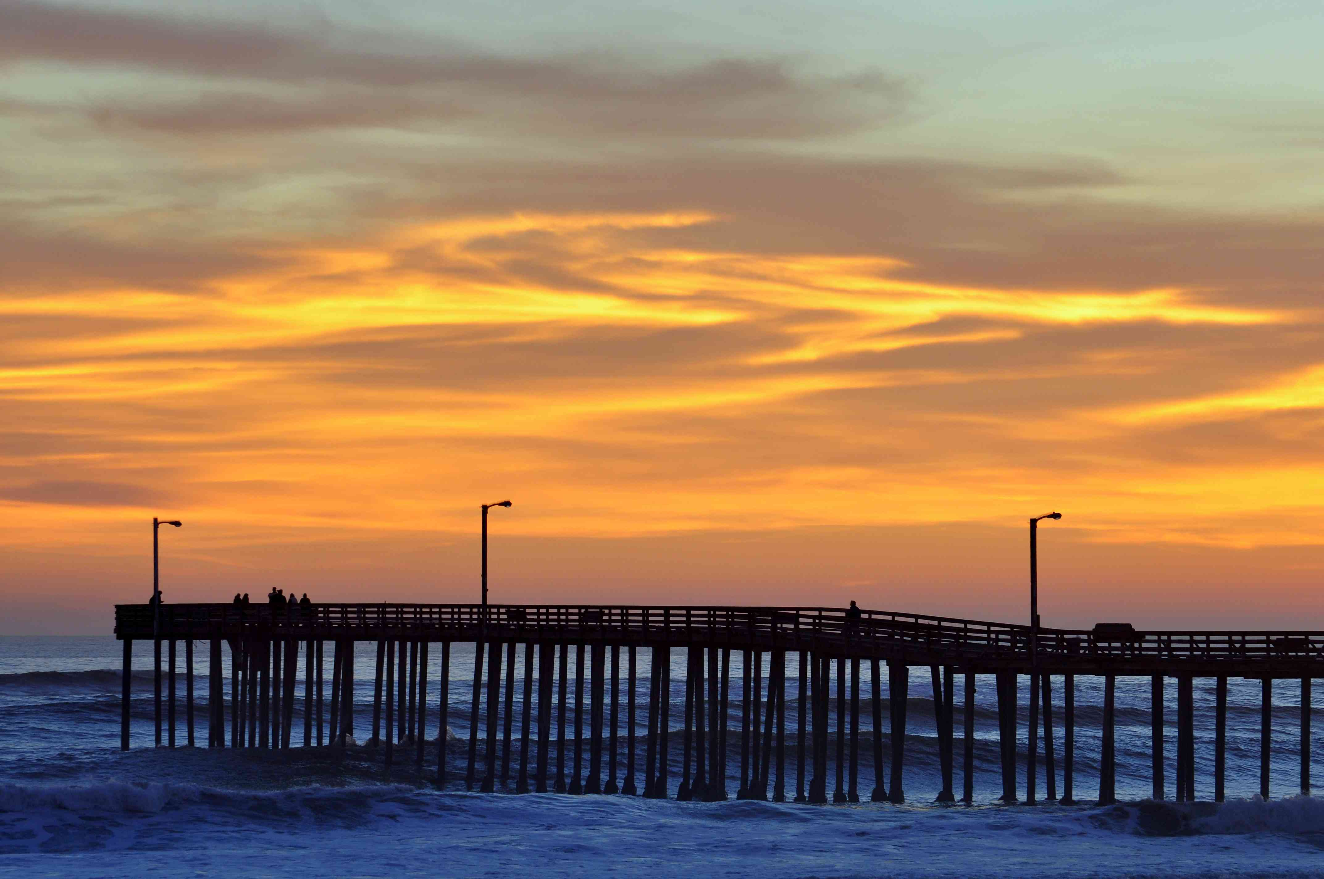 Cayucos Pier silhouetted by the sunset