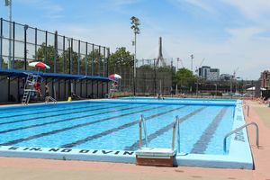 Empty swimming pool with two lifeguard towers in Boston