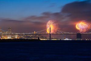 Fourth of July Fireworks Over Bay Bridge and San Francisco Skyline viewed from Alameda Island, California, USA