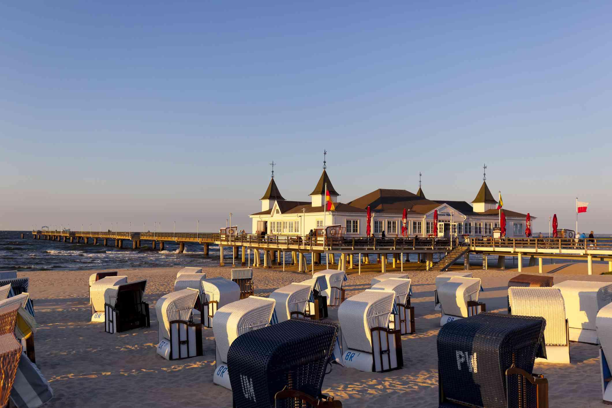 Germany, Usedom Island, Ahlbeck, sea bridge and beach chairs