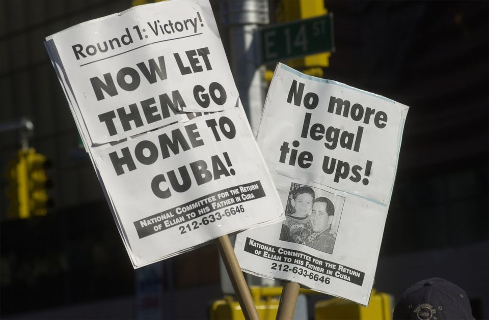Signs favoring Elian Gonzalez's return to Cuba...