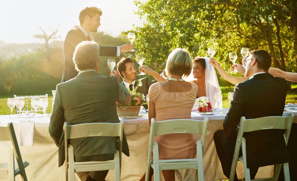 Man giving toast at wedding reception