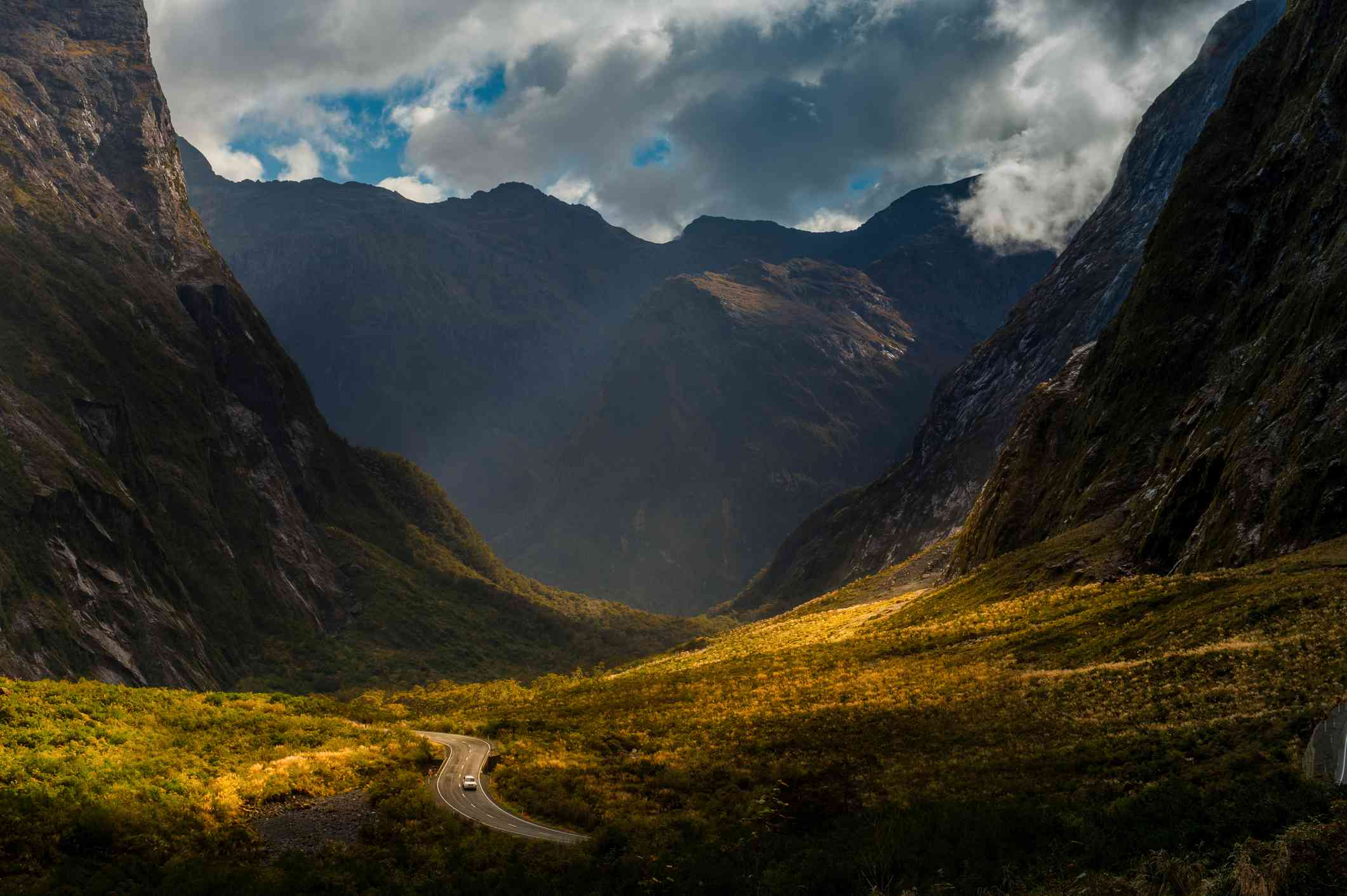 road leading through steep dark mountains