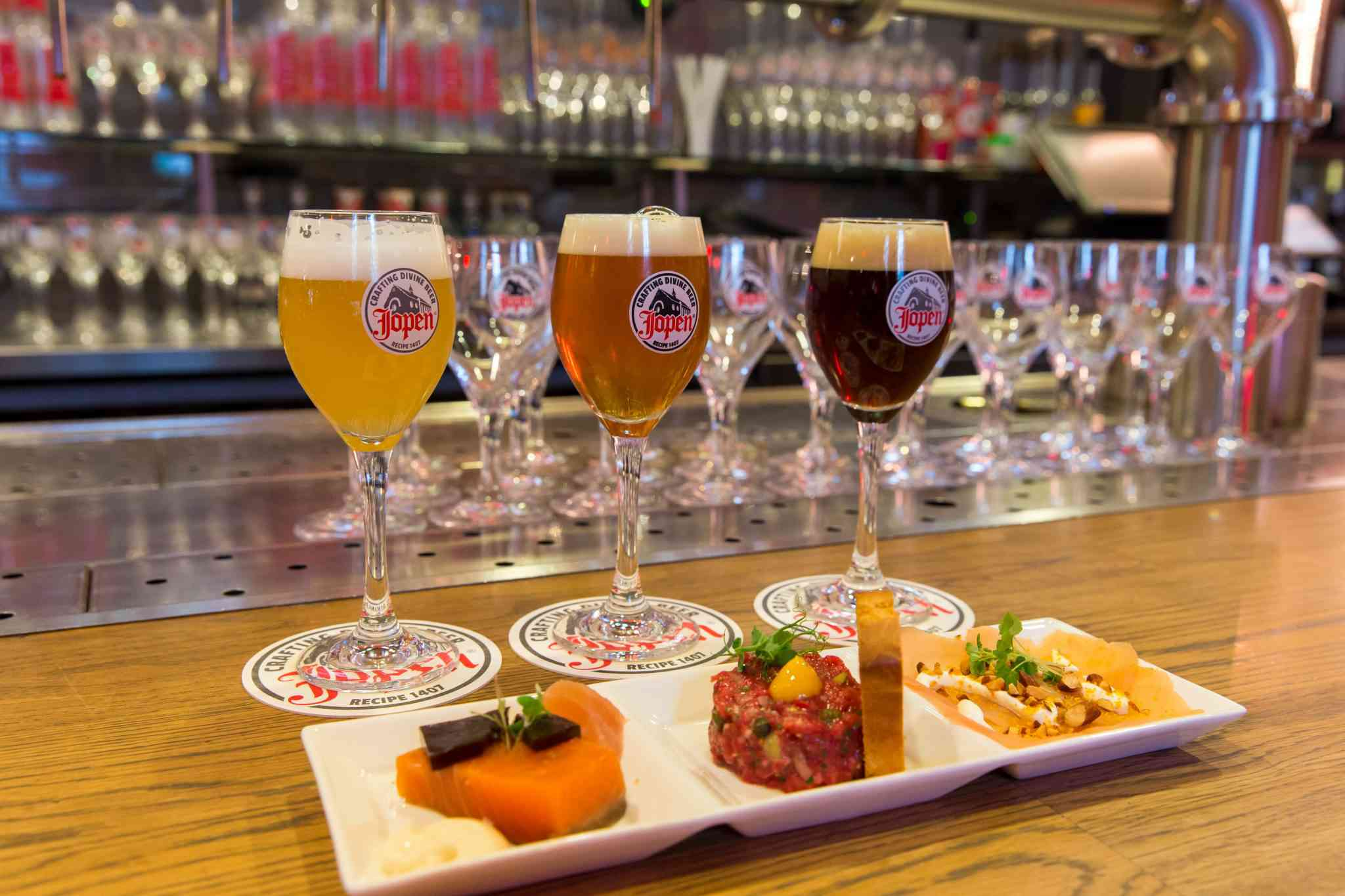 Three amuse bouches infront of three glasses of beer at Jopenkerk Haarlem