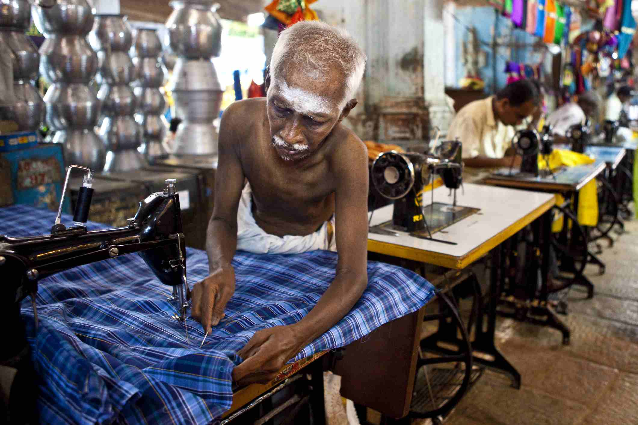 Tailor at work at market in Puthu Mandapam.