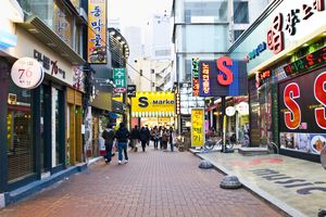 Young Koreans on a shopping street in downtown Daegu.