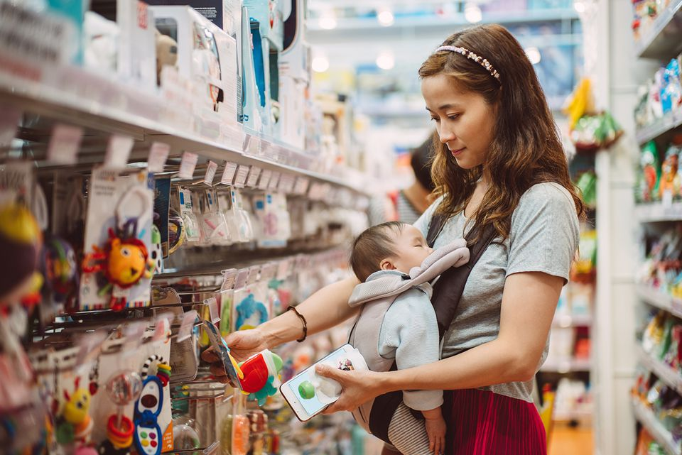 Mom with baby shopping in a toy store
