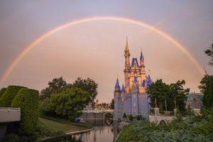 Cinderella Castle Disney World with rainbow