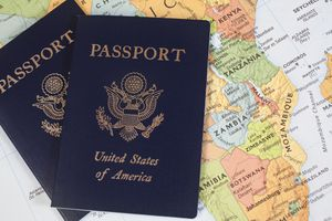 American passport over map of Africa