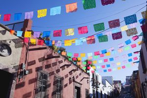 Paper flags hanging over courtyard