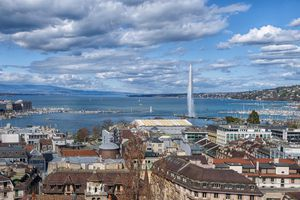 Cityscape of Geneva, with the lake and the fountain Jet d'Eau. one of the city's most famous landmarks.