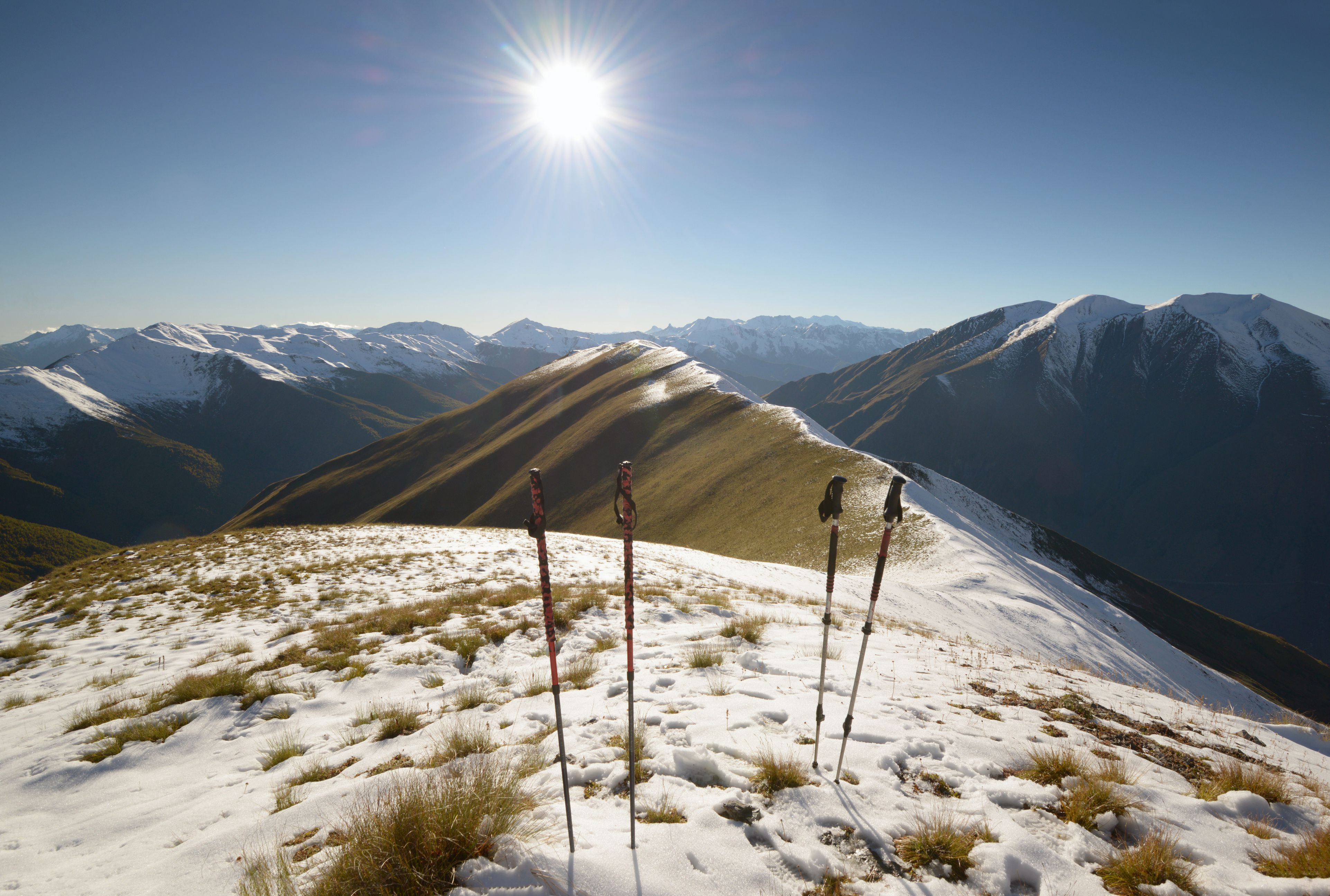Hiking poles on top of a mountain ridge