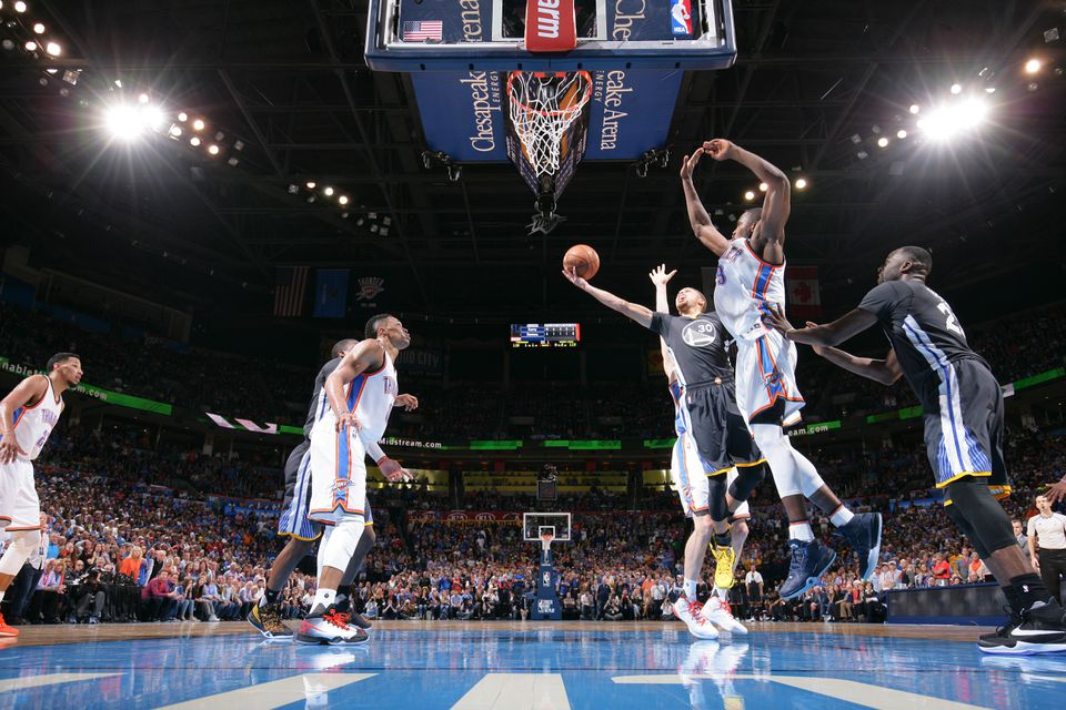 The Golden State Warriors player goes to the basket against the Oklahoma City Thunder