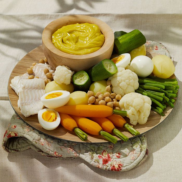 platter of boiled vegetables and a bowl of aioli