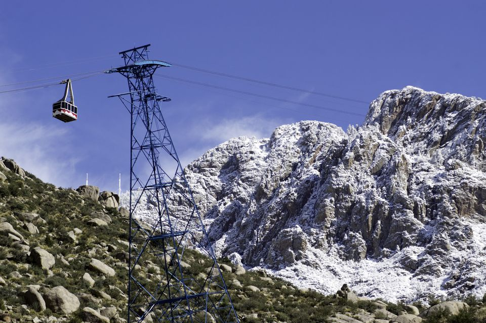 A Snowy Sandia peak and the Sandia Peak Tram